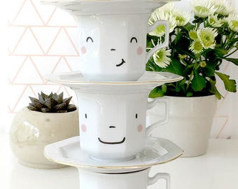 4  hand-printed smiling faces cups
