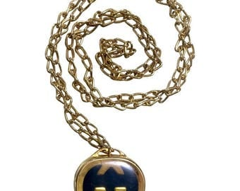 Vintage Gucci gold skinny chain long necklace with navy oval shape pill case design pendant top. Perfect Gucci gift.