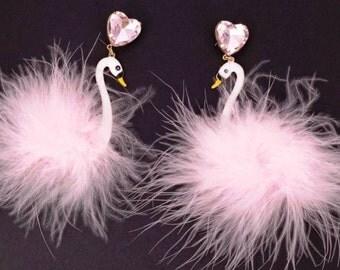 Fancy, whimsica,l dangling, feather swan earrings. 4 inch drop.
