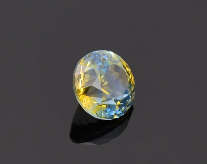 Remarkable Yellow Blue Sapphire Gemstone from Montana 2.03 cts. 7.0 mm. Round Shape.