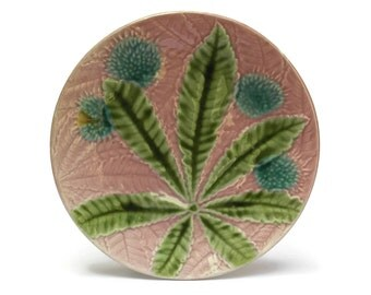 Antique Pink Majolica Wall Plate with Blue Flowers and Leaves.