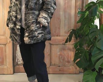 Gray and white astrakhan fur coat