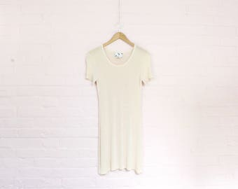 shiny light nude 90s babydoll dress · 1990s minidress baby doll dress · 90s ultra stretch mini dress · 90s minimalist pastel mini dress · M