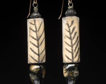 Bone Simple, rustic assemblage earrings made with artisan beads of clay, paper, antique black wood and 14K GF handmade ear wires.