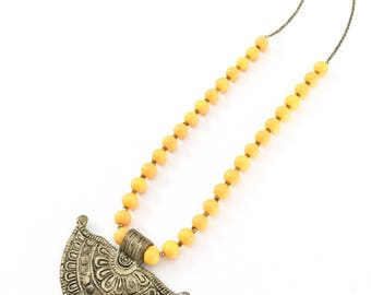 The Beaded Boho - brass engraved Tibetan pendant necklace.
