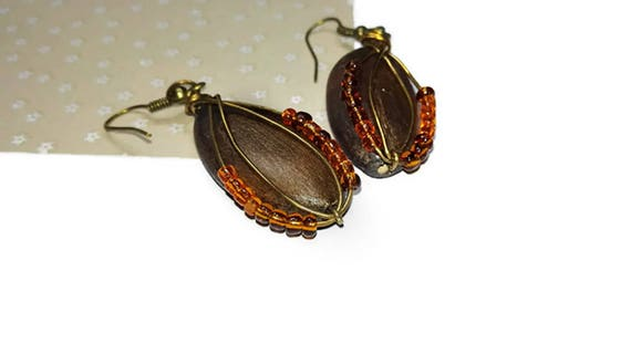 Long brown recycled wooden bead dangle earrings