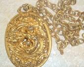 Napier Large Runway Style Ornate Cherub Pendant Necklace