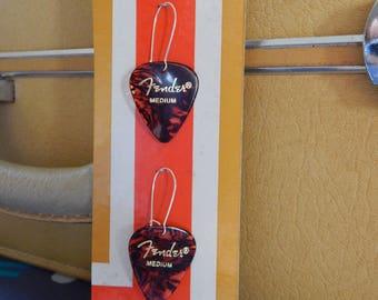Fender Guitar Pick Earrings, Brown/Tortoise Shell- displayed on vintage album art