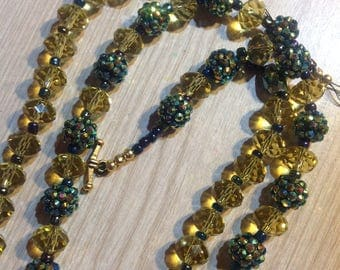 Double strand. Bling that sparkles in blue, green and lemon crystal.