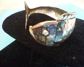 Sterling silver and mother of pearl fish motif bracelet.