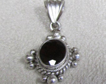 Sterling Silver and Faceted Garnet Pendant