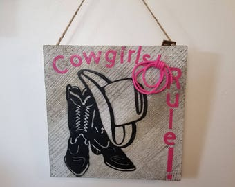 Cowgirl's Rule! Metal cowboy boots and hat.