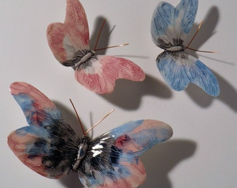 Hand-painted and made ceramic butterflies. The colors are fictional but the forms are real butterflies.
