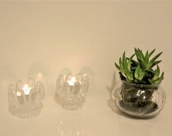 Pair of vintage clear glass Kosta Boda Sunflower candle holders, designed by Göran Wärff for Kosta Boda. Made in Sweden