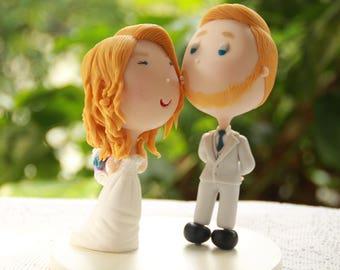Groom kissing bride on the cheek. Wedding cake topper. Wedding figurine. Bride and Groom. Handmade. Fully customizable. Unique keepsake