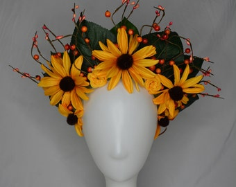large yellow garden flower crown with leaves and berries.