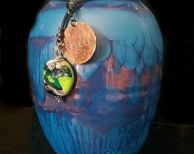 Small Handcrafted Raku fired Porcelain Urn in Deep Blue with matching Blown Glass Pendant. Pet Memorials, ashes in glass