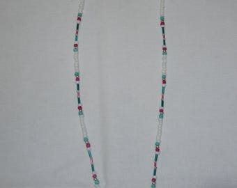 White, pink, and teal beaded necklace with sterling silver accent