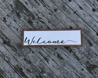 Welcome -- wood sign
