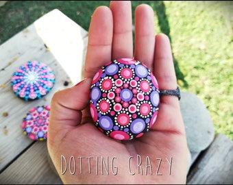Dot art. Mandala rock. Mandala painted on stone. Gift decoration. Pointillism. Red and violet. Yoga. Meditation. Aboriginal art.