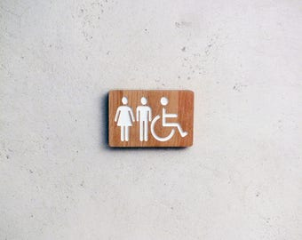 Bathroom wooden door sign with engraved male / female and handicap pictograms. Mixt and disabled restroom sign.