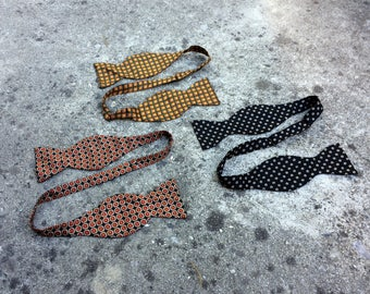 Three Vibrant Bows -- A lot of patterned silky bow ties -- F. R. Tripler & Co.