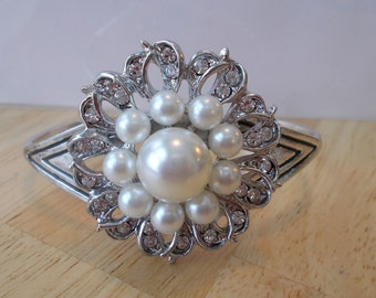 silver Tone Cuff Bracelet with a Silver, White Sea Shell Pearls and Clear Rhinestone Brooch Center