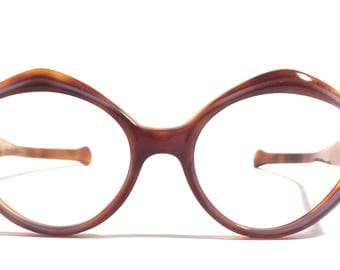 Vintage eyewear. Fabulous unique style! 1960's. Tortoise and midnight moon color. Excellent quality and condition! Made in USA. Hip women!
