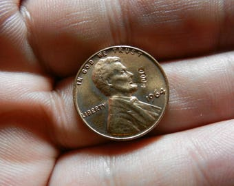 Vintage 1964 Penny with Lincoln Smoking a pipe