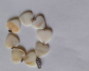 Heart shaped beaded bracelet with charm