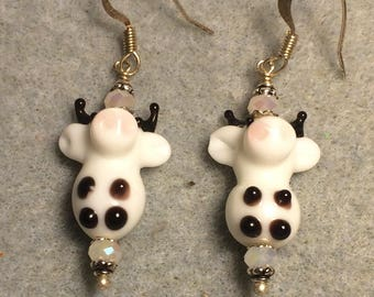 White and brown lampwork cow bead earrings adorned with white Chinese crystal beads.