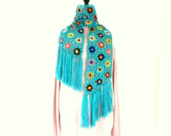 Turquoise crochet scarf and multicolored flowers fringed