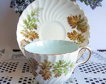 Aynsley C1314/1 with Brown to Grey Fern Fronds Swirled,Flat, Light Blue inside Bone China Tea Cup and Saucer