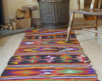 Vintage handwoven hemp runner with geometric design.