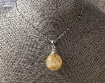 Citrine pendant bubble: resin and semi-precious stone chips, steel necklace.