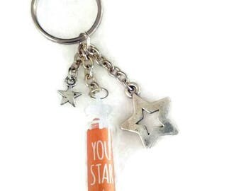 """Keychain with message """"you star"""" and star charms"""