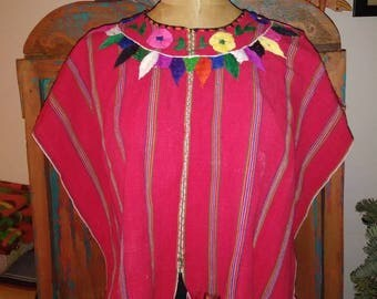 Outstanding vintage embroidered poncho.