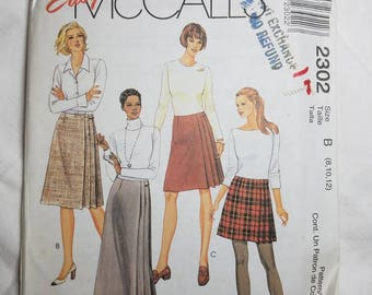 Easy McCall's 2302 Misses' Wrap Skirt in Four Lengths, Front and Back Darts and Two Pleats with Velcro Closure at Left Side. Size 8-10-12
