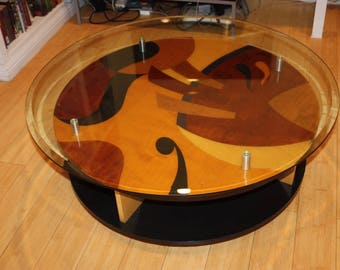 "Coffee table, Custom Made, 42"" in diameter, on wheels to move around easy(wheels lock)"