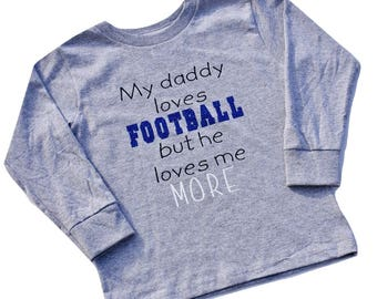 My daddy loves football but he loves me more toddler/youth long sleeve shirt