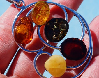 Stunning Multi Color Genuine Baltic Amber set in Solid 925 Sterling Silver Pendant by Silver Trend