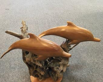 Handmade Dolphin sculpture on a Driftwood base.
