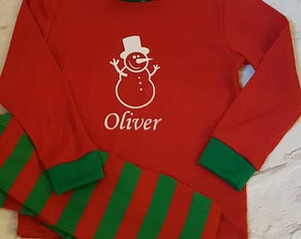 Children's Christmas Personalised Pyjamas, Personalised Kids Pyjama Sets, Snowman Design, Christmas Eve Gift And Keepsake.