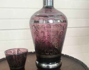 Amethyst glass with silver overlay decanter and shot glass