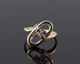 14k 0.17 CTW Ruby Diamond Oval Bypass Ring Gold