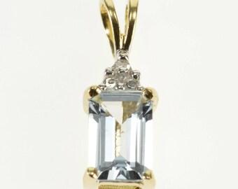 10k Emerald Cut Blue Topaz Diamond Accented Pendant Gold
