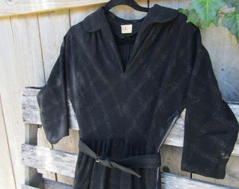 Vintage 1950's black knit lurex sweater dress