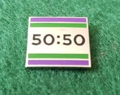 50:50 lapel pin in nickel. Subtle but powerful statement for political equality