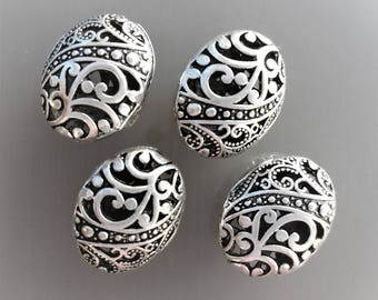 4 large oval beads in silver color metal