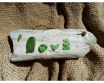 "Label ""Love"" with green glasses smoothed by the sea on stick beached Shabbat of white"